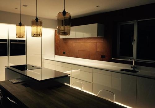 Modern kitchen with smoke glass lampshades