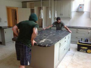 Installing Cosmic Black leather granite worktops