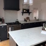Navy and quartz kitchen