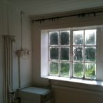 Before picture, old windows, exposed pipes
